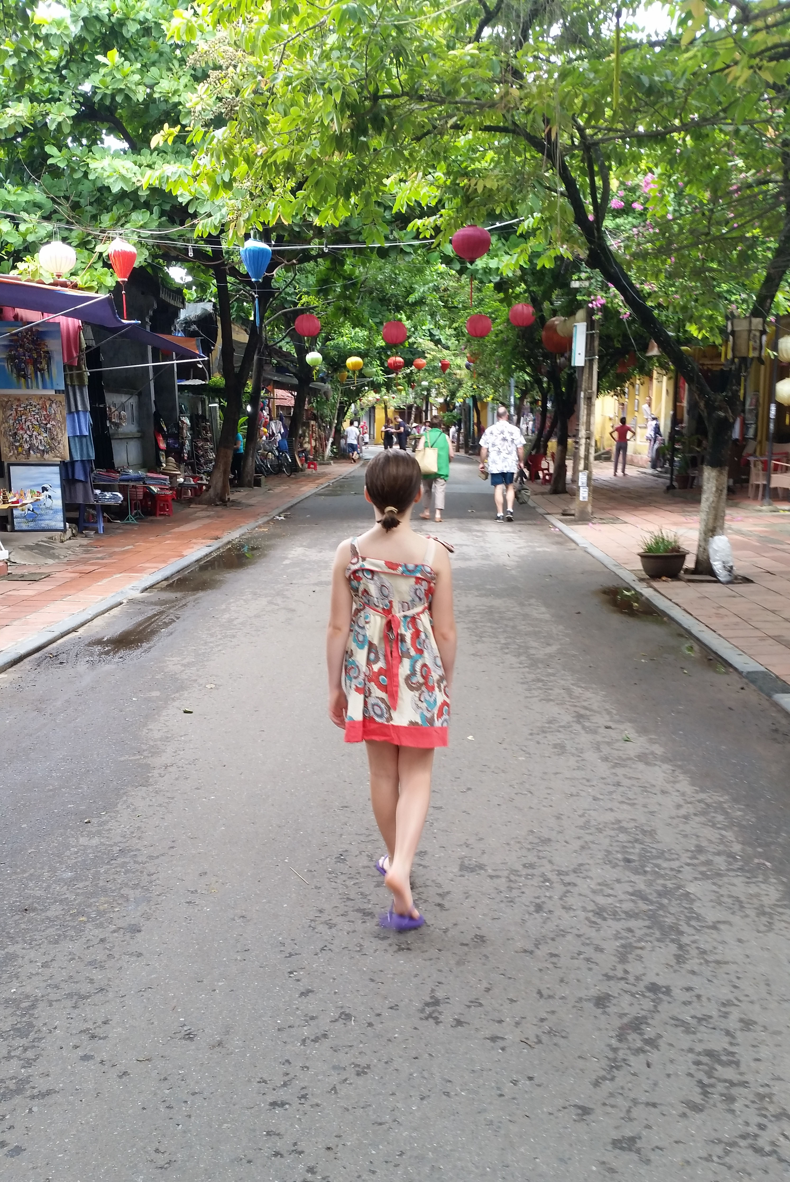 little girl walking on the street during Goddess Outdoor Fitness Vietnam Trip