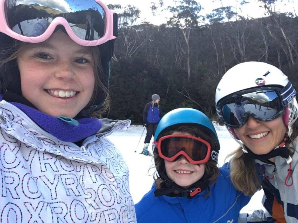 Amy Mitchell having fun with her girls at the snow